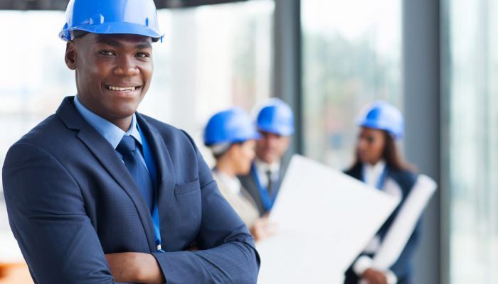 male construction manager with arms folded